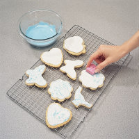 A sponge being  used to apply icing for cookie decoration.
