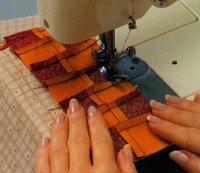 Stitch checkered piece to beige print to make vest front.