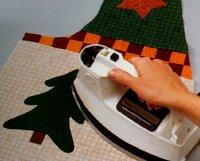 Press pattern onto Christmas vest front.