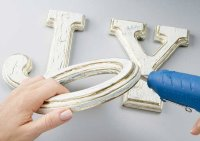 Hot glue the O at an angle to the J and the Y.