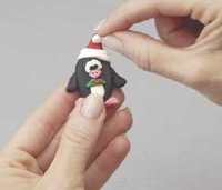 Make a Santa Claus hat and place it on top of the penguin.