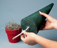 Cut the foam to fit your pot and insert a twig into the flat end.