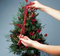Make a bow from two yards of ribbon and drape it over the tree.
