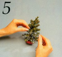 Starting at the bottom, glue the star garland to the tree.