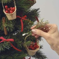 Bundle the baby's breath and place it on the tree.