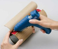 Wrap corrugated cardboard around the outside of the tube and glue into place.