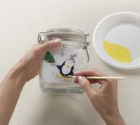 Use enamel to paint the penguin on the jar.