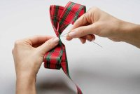 Form plaid bow to make the Christmas centerpiece.