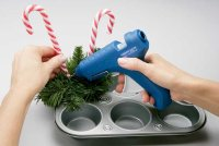 Glue candy canes into cluster of greens.