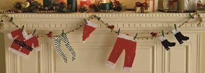 Santa Hangs It Up Christmas garland.