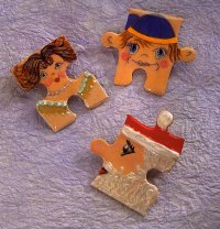 Santa's Puzzle Pin is a great Christmas gift and way to wear Santa-themed Christmas jewelry.