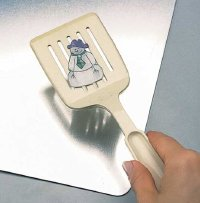Use a spatula to remove snowman pins from tray.