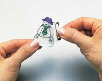 Stick adhesive pin back to make Snowman pin Christmas jewelry.