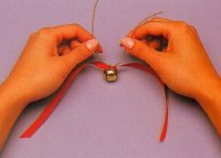 Pull the ends of the cord to tie in a square knot.