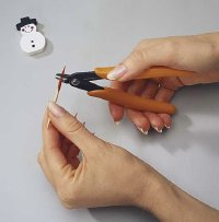 Cut off end of toothpick to make a snowman pin as a nice Christmas jewelry.