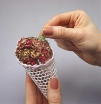 Insert flowers into cone to make Victorian ornament.