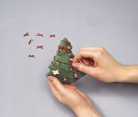 Sew the ornaments to the tree in a symmetrical pattern.
