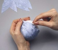 Distribute the pieces of fabric evenly around the foam ball.