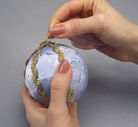 Cover the seams on the ornament with the gold ribbon.
