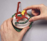 To finish the Noel Rocking Horse ornament, glue the horse to the muslin.