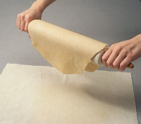 Roll dough over rolling pin when making single crust pastries.