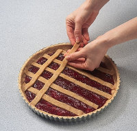 Arrange dough lengthwise and crosswise when making lattice crust pie pastries.