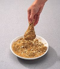 Use your hands to sprinkle breading.