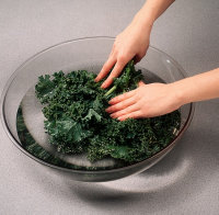 Thoroughly rinse the kale in a large bowl of water.
