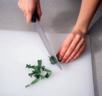 Roll up the kale leaves and cut them crosswise.