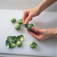 Cut the stem from each Brussels sprout and remove the damaged leaves.