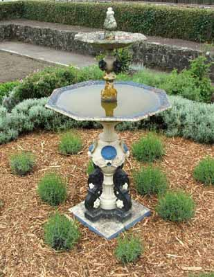 The mulch on this fountain garden helps prevent weeds and gives the landscape a neat, defined appearance.