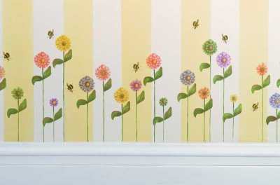 Flowers and bees line the walls, making a summery border.