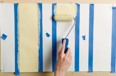 Paint yellow stripes in between the tape markings, alternating each one.