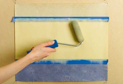 A sponge roller is the easiest way to lay the basecoat between the tape borders.
