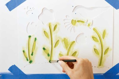 Stencil the stems of the flowers in green paint.