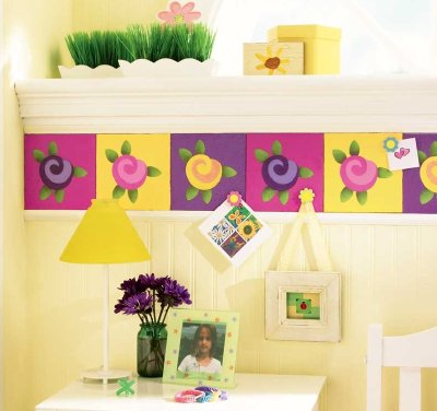 The Funky Flowers Cork Border features bright and colorful patterns stenciled on a useful cork surface.