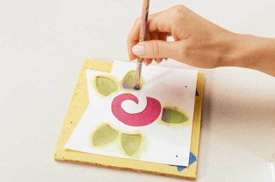 Stencil a swirl on each flower to make it more lively.