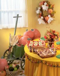 Create a beautiful hearth with fall decorations for this historical Halloween party.