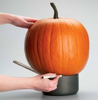 Set the pumpkin on a cooking pot before cutting the bottom of a crooked pumpkin.