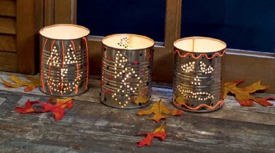 Draw shapes onto the cans to make your own Halloween candles.