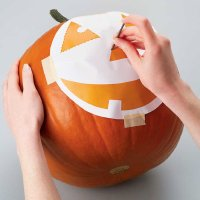 Trace the outline of the pattern by poking small holes into the pumpkin.