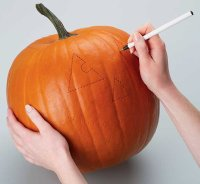 Use a pen to connect the dots when carving a pumpkin.