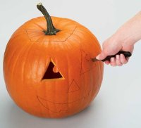 Carve pumpkin with a sewing machine motion.