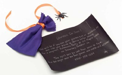 Place invitations into a charm pouch when throwing a Halloween party.
