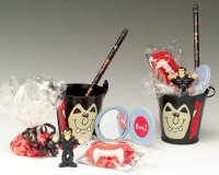 Vampire fangs, mirrors, and Vampire pails are great Halloween goodie bags.