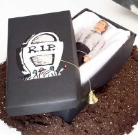 Use a shoebox and a doll to create a coffin Halloween game.