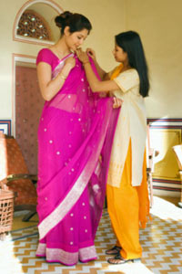 60ad70e7b Women throughout India wear traditional saris made of cotton, silk or  factory blends that are