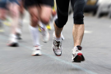 Legs of person running in race