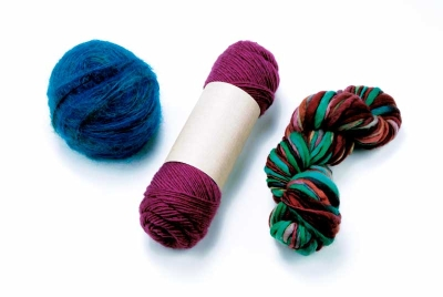 Your journey into the world of knitting begins with needles and some yarn.