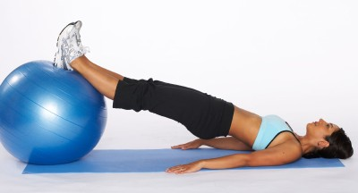 how to do a hamstring curl with stability ball step two
